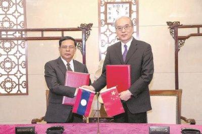 张军会见老挝最高人民检察院检察长坎山・苏冯